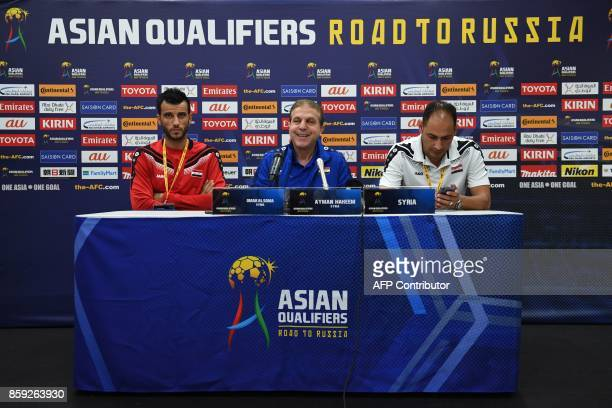 Syria coach Ayman Alhkeem smiles as he sits with team member Omar Alsoma during a press conference in Sydney on October 9 on the eve of their 2018...