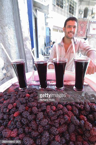 syria, damascus, souq al-hamidyya, man selling refreshments - damascus stock pictures, royalty-free photos & images