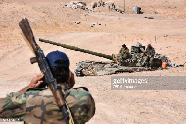 Syria forces begin their advance on the area of Bughayliyah on the northern outskirts of Deir Ezzor on September 13 during their ongoing battle...