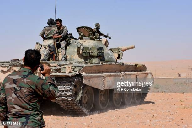 Syria government forces advance in AlShula on the southwestern outskirts of Deir Ezzor on September 7 during the ongoing battle against Islamic State...