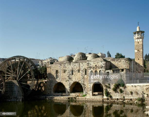 Syria Hama AnNuri Mosque built by Nur AlDin 12th century On the left medieval noria near the Orontes river