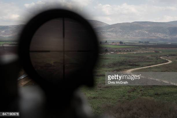 Syria is seen through a high powered scope situated on a tower at a 1st Border Regiment Command outpost during military drills on the Turkey/Syria...