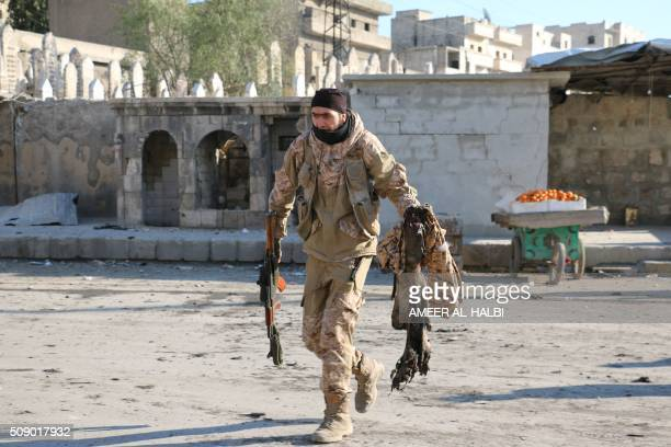 A Syria man carries a body part following a reported Syrian regime air strike in a rebelcontrolled area in the northern city of Aleppo on February 8...