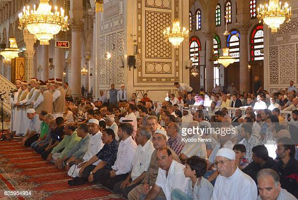 DAMASCUS Syria Muslims attend a Friday prayer meeting at Umayyad Mosque in Damascus Syria on Sept 20 2013