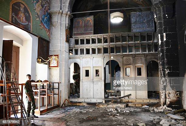 MAALOULA Syria Photo taken May 14 shows St Thecla Monastery in the Christian village of Maaloula southern Syria where a burned column is seen...