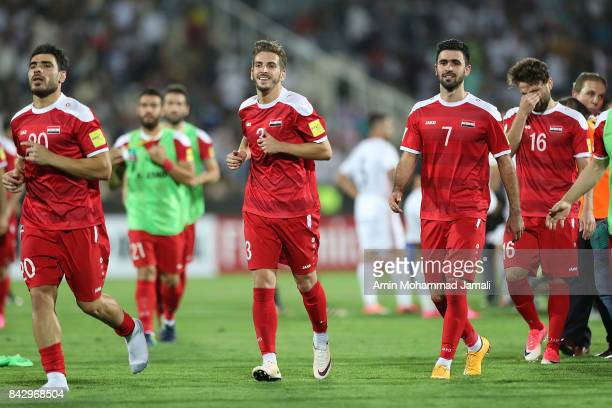 Syria players celebrate at the final whistle during FIFA 2018 World Cup Qualifier match between Iran v Syria on September 5 2017 in Tehran Iran