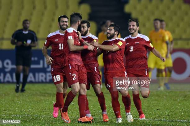 Syria players celebrates after the equalising goal against China during the 2018 FIFA World Cup Asian Qualifier Group A Final Round match between...