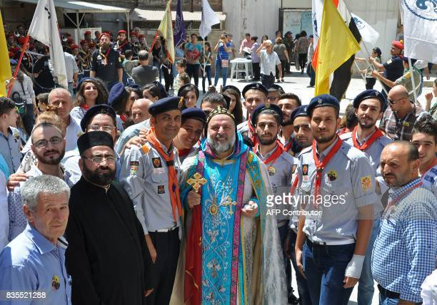 Syriac Orthodox Christians pose for a photo with Hasakeh's newly appointed bishop Maurice Amseeh following inauguration at the Saint George Cathedral...