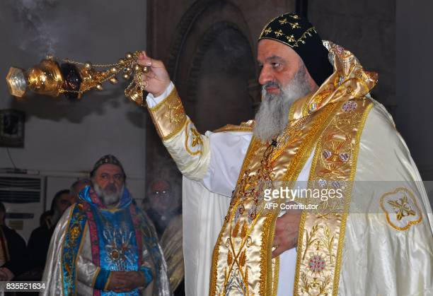 Syriac Orthodox Patriarch Mar Ignatius Aphrem II wafts incense as Hasakeh's newly appointed bishop Maurice Amseeh watches on during his inauguration...
