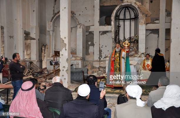 Syriac Orthodox Patriarch of Antioch Ignatius Aphrem II gives a sermon during mass at the heavily damaged Syriac Orthodox church of St Mary in...