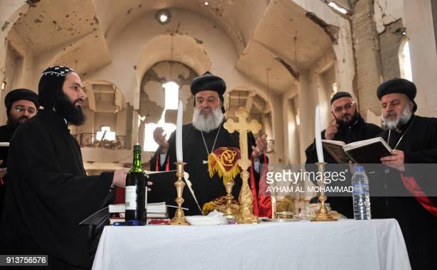 Syriac Orthodox Patriarch of Antioch, Ignatius Aphrem II, holds mass at the heavily damaged Syriac Orthodox church of St. Mary in Syria's eastern...