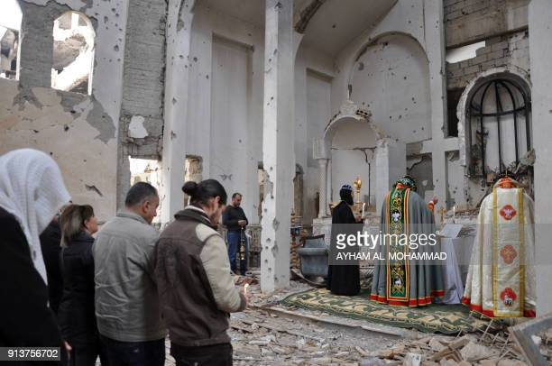 TOPSHOT Syriac Orthodox Patriarch of Antioch Ignatius Aphrem II holds mass at the heavily damaged Syriac Orthodox church of St Mary in Syria's...