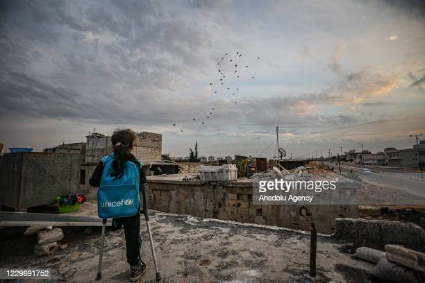 Syrian 9-year-old Fatima Ahmed al-Mustafa who lost her left leg in an airstrike of Assads regime and its supporters, is seen in Idlib, Syria on...