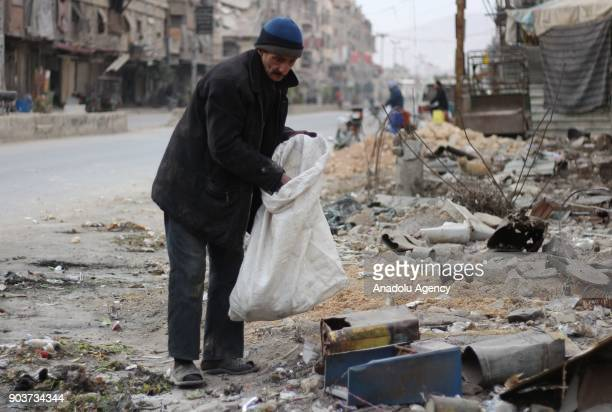 Syrian Abu Qasim who lost his job due to health issues after Assad Regime's blockage on Easthern Ghouta collects garbage to sell and provide for his...
