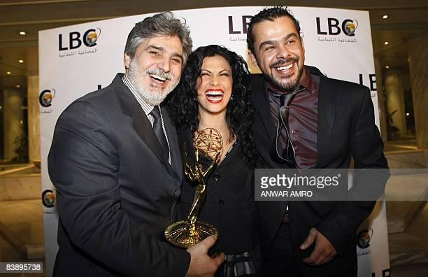 Syrian actor Abbas alNuri Jordanian actress Siba Mubarak and Jordanian actor Munzer Rayahneh pose with an Emmy award for the series 'AlIgtiyah' at...