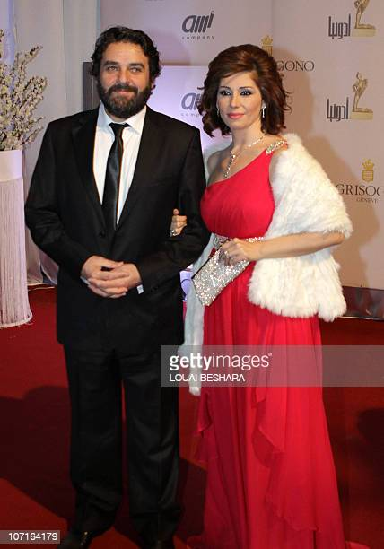 Syrian actor Maher Salibi arrives with his wife actress Yara Sabri to attend the Adonia Awards party in Damascus late on November 26 2010 AFP...