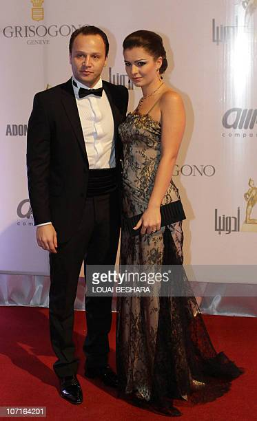 Syrian actor Maxim Khalil arrives with his wife actress Sawsan Arshid to attend the Adonia Awards party in Damascus late on November 26 2010 AFP...