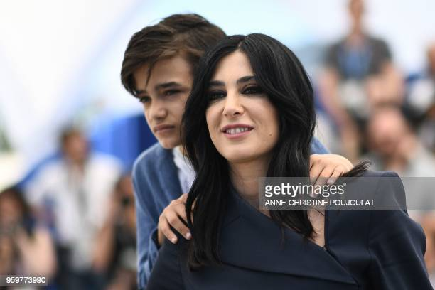 Syrian actor Zain alRafeea and Lebanese director and actress Nadine Labaki pose on May 18 2018 during a photocall for the film Capharnaum at the 71st...