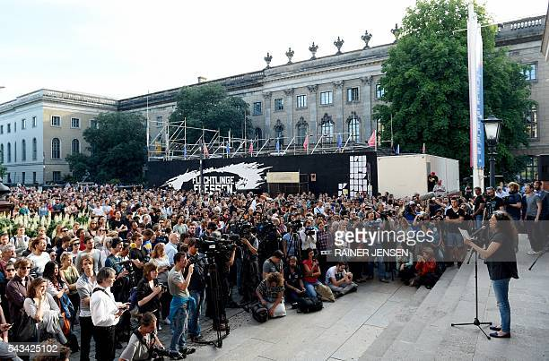 Syrian actress May Skaf speaks in front of the GorkiTheater in Berlin on June 28 2016 after the plans by German activists of the socalled 'Center for...