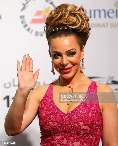 Syrian actress Suzan Najm Al Deen arrives to the opening session of the 11th Dubai International Film Festival in Dubai on December 10 2014 AFP PHOTO...