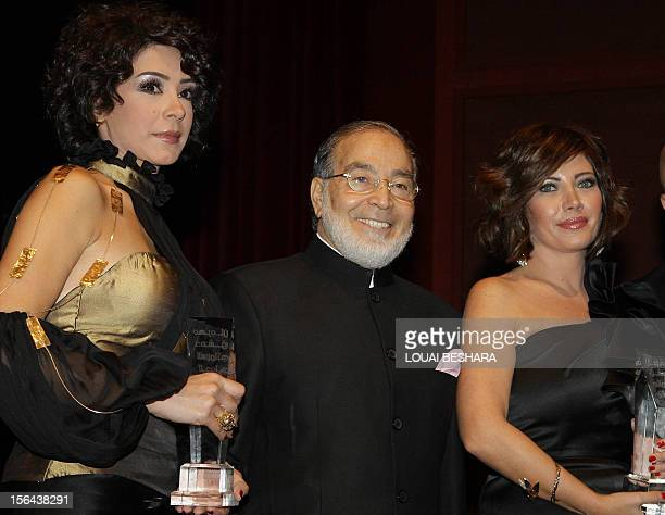 Syrian actresses Carisse Bashar and Sulafa Memar pose for a picture with Egypt's veteran actor Hassan Yussef during the opening ceremony of the...