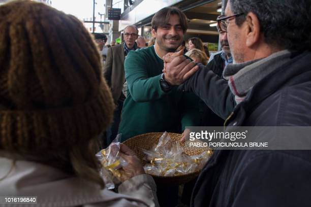 Syrian Ahmed Adnan Ahjam a former Guantanamo inmate greets a customer during the opening of his Arab gastronomy shop at the Mercado Agricola in...