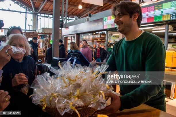 Syrian Ahmed Adnan Ahjam a former Guantanamo inmate offers sweets during the opening of his Arab gastronomy shop at the Mercado Agricola in...
