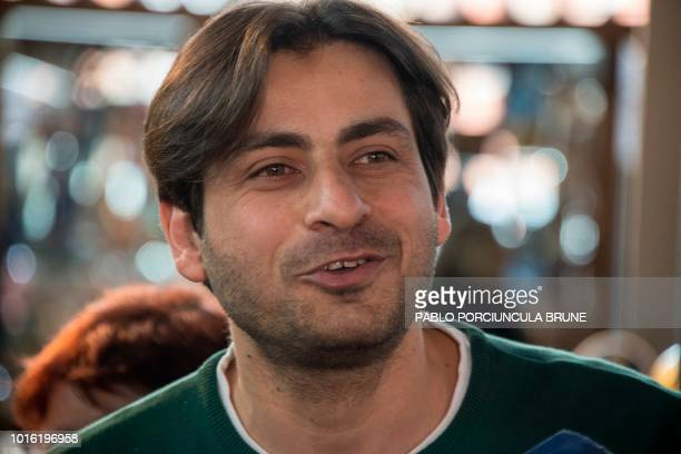 Syrian Ahmed Adnan Ahjam a former Guantanamo inmate speaks during the opening of his Arab gastronomy shop at the Mercado Agricola in Montevideo on...