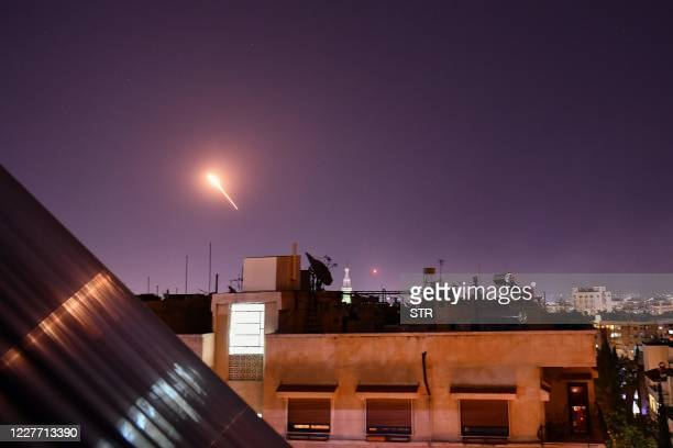 Syrian Air defences respond to Israeli missiles targeting south of the capital Damascus, on July 20, 2020. - Israeli strikes south of the Syrian...