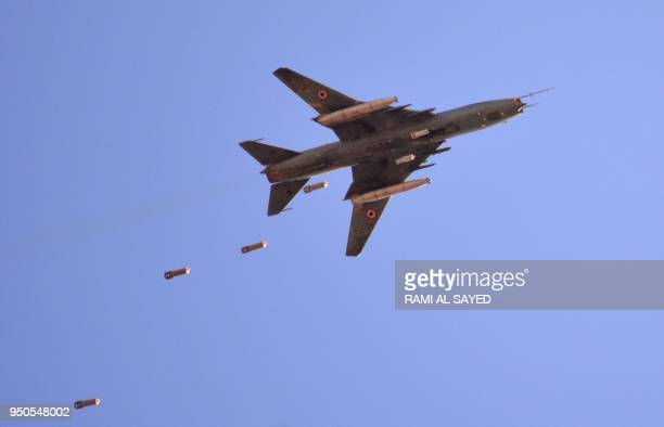 Sukhoi Su22 Syrian army plane releases bombs over southern Damascus in the area of Yarmuk Palestinian refugee camp on April 24 2018 Forces loyal to...