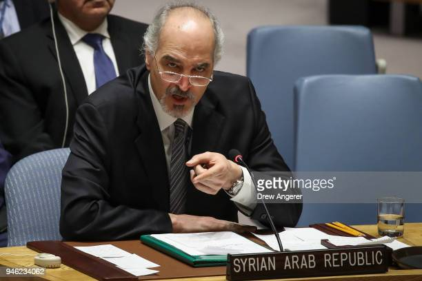 Syrian ambassador to the United Nations Bashar Jaafari speaks during a United Nations Security Council emergency meeting concerning the situation in...