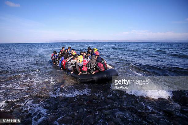Syrian and many Afghan migrants / refugees arrive from Turkey on boat through sea with cold water near Molyvos Lesbos on overloaded dinghies Leaving...