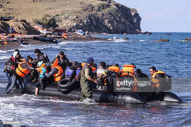 Syrian and many Afghan migrants / refugees arrive from Turkey on boat through sea with cold water near Molyvos, Lesbos on overloaded dinghies....