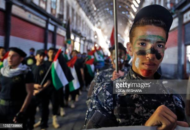 Syrian and Palestinian children take part in a rally to mark al-Quds International Day, on May 7 at the covered bazaar of Hamidiya in Syria's capital...