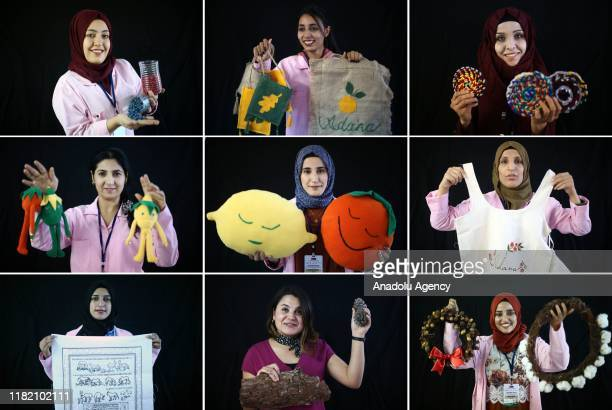 Syrian and Turkish women hold handiworks made in a course on art works handcrafts and souvenir production within a cooperative project named Ekmek...