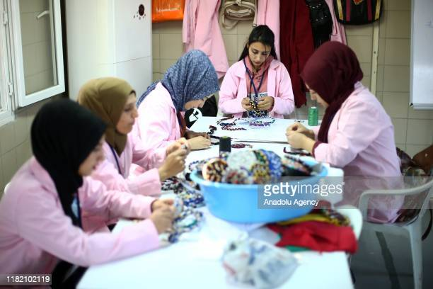 Syrian and Turkish women work on handiworks made in a course on art works handcrafts and souvenir production within a cooperative project named Ekmek...