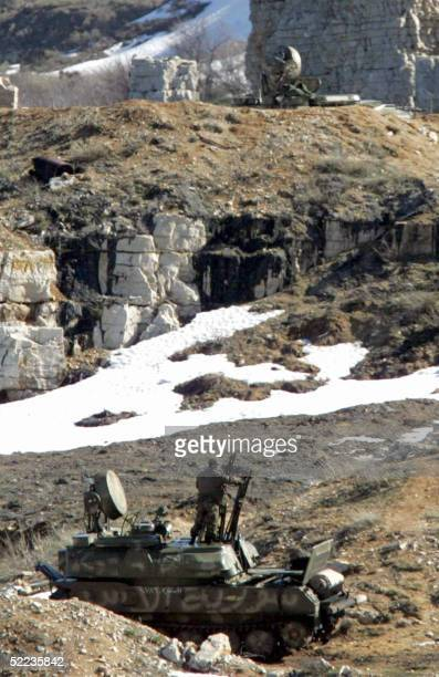 """Syrian anti-aircraft vehicle is parked on a hill in the Bekaa Valley 24 February 2005. Syria will start """"in the next few hours"""" the final pullback of..."""
