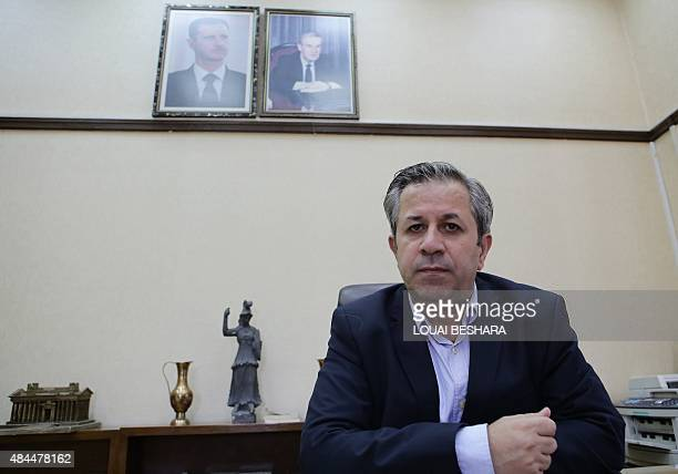 Syrian antiquities chief Maamoun Abdulkarim poses for a photo at his office in Damascus as he speaks to AFP on August 19 2015 after the Islamic State...