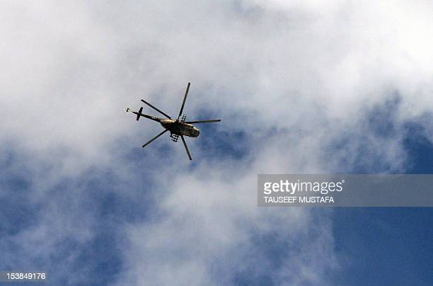 Syrian army helicopter flies over the northern city of Aleppo on October 9, 2012. Syrian rebels overrun Maaret al-Numan, a strategic Idlib province...