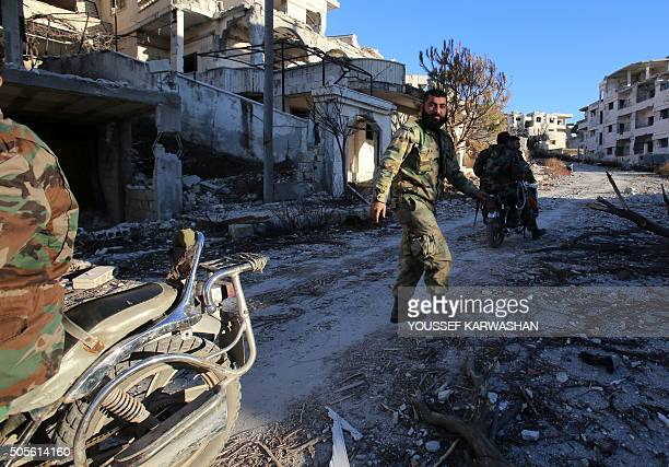 A Syrian army soldier rides a motorcycle in the village of Salma in the northwestern province of Latakia on January 15 2016 As Syrian forces battled...