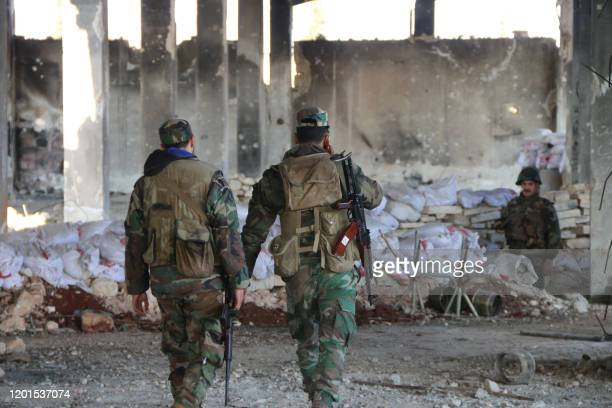 Syrian army soldiers advance on an area in the northern Aleppo countryside on February 17 2020 In recent weeks Syrian troops and allied forces backed...