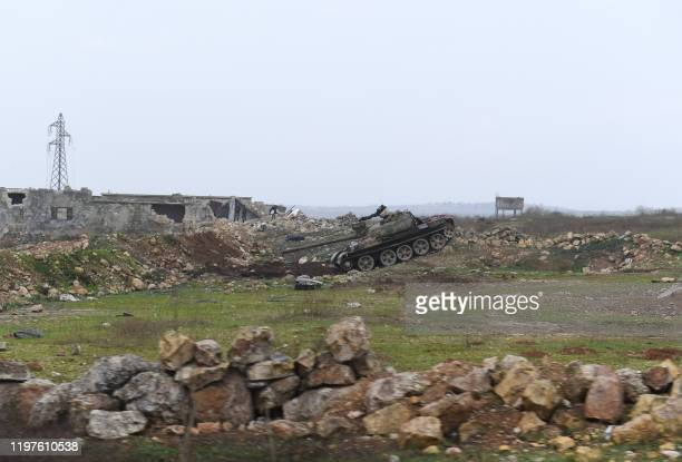 Syrian army tank advances in the Tallet el Abyad area in Aleppo's southwestern countryside during an ongoing pro-government offensive, on January 30,...