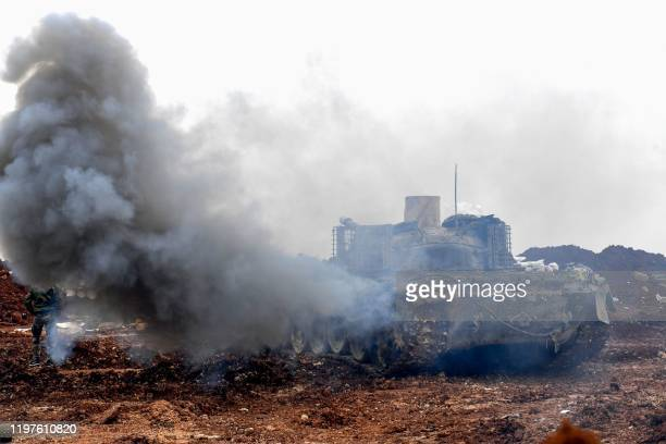A Syrian army tank advances in the Tallet el Abyad area in Aleppo's southwestern countryside during an ongoing progovernment offensive on January 30...