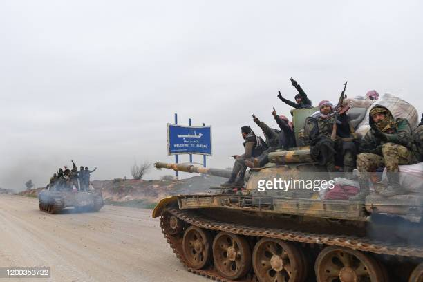 Syrian army troops advance towards the rebel-held areas of the northern Aleppo province on February 12, 2020. - Syrian regime forces pushed on with...