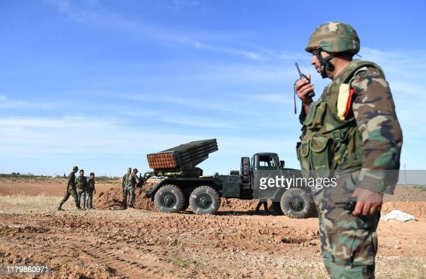 Syrian army units deploy with their heavy weapons in the countryside of the city of al-Bab in the Aleppo governorate on November 3, 2019.