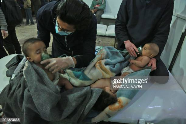TOPSHOT Syrian babies receive treatment for a suspected chemical attack at a makeshift clinic on the rebelheld village of alShifuniyah in the Eastern...