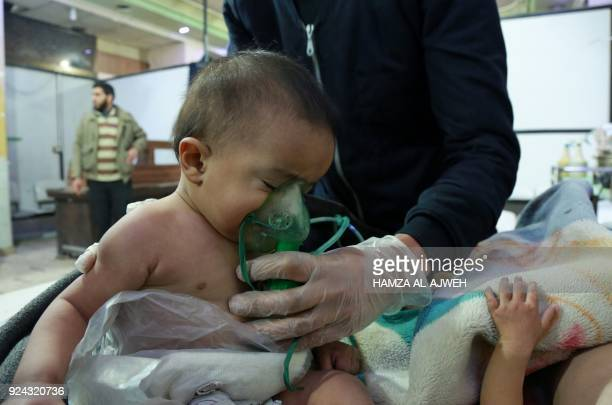 Syrian babies receive treatment for a suspected chemical attack at a makeshift clinic on the rebelheld village of alShifuniyah in the Eastern Ghouta...