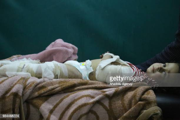 Syrian baby is seen after receiving medical treatment at a hospital after Assad Regime's attacks over Eastern Ghouta's Zemelka town in Damascus Syria...