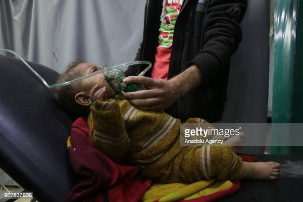 Syrian baby receives medical treatment at the field hospital after Assad Regime's alleged chlorine gas attack in Hamouriyah district of Eastern...