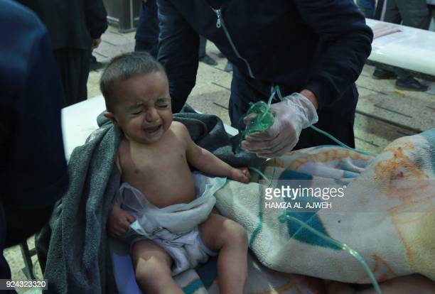 A Syrian baby receives treatment following a suspected chemical attack at a makeshift clinic on the rebelheld village of alShifuniyah in the Eastern...